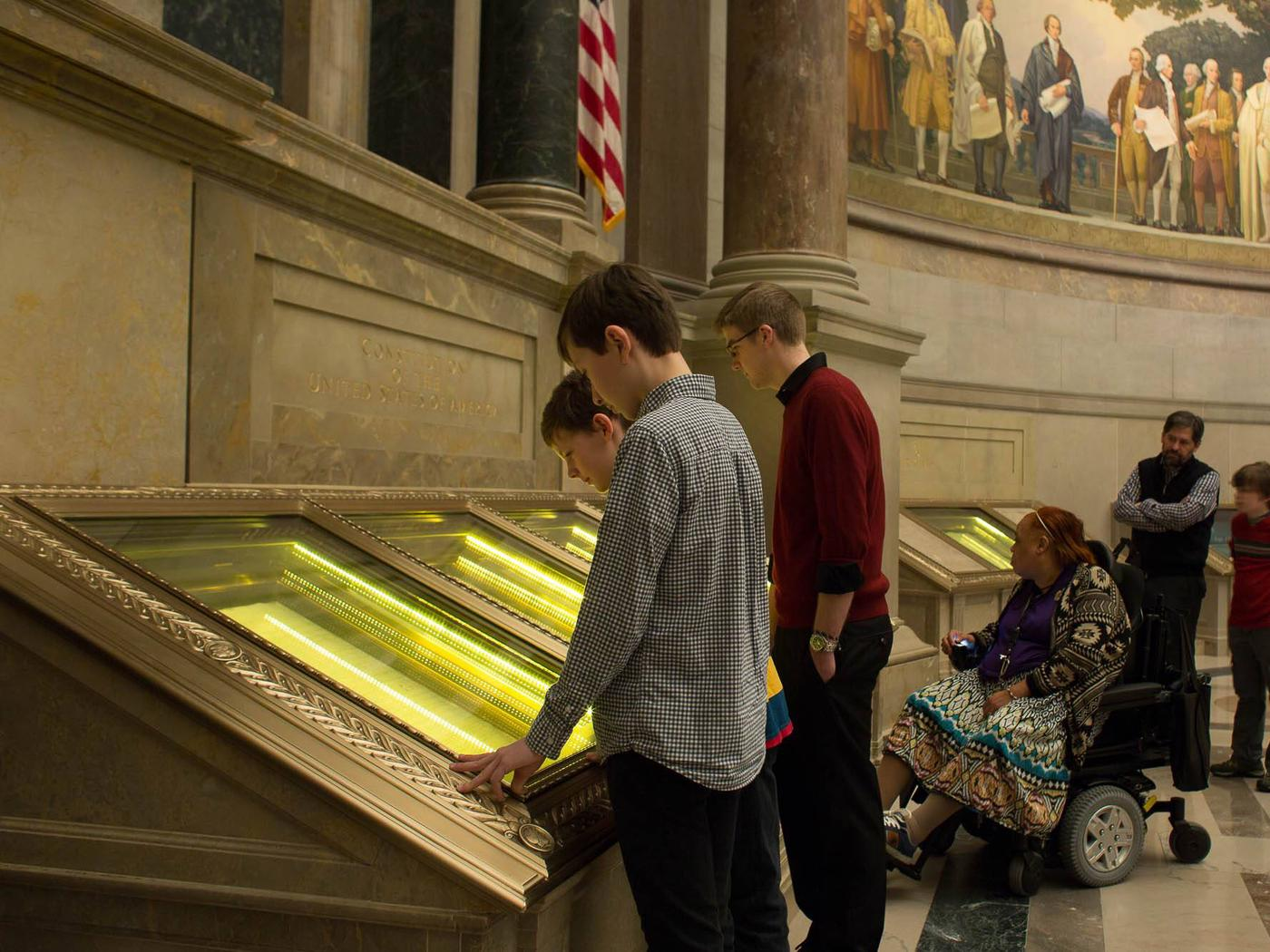 Visitors viewing the US Constitution in The Rotunda for the Charters of Freedom