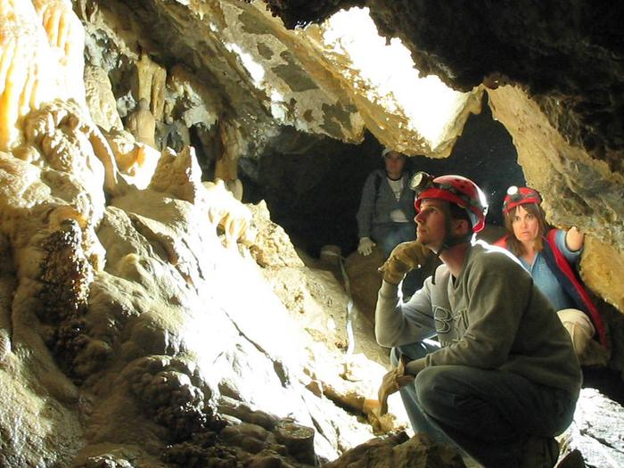 Cavers with hard hats and headlampsIntroduction to Caving Tour