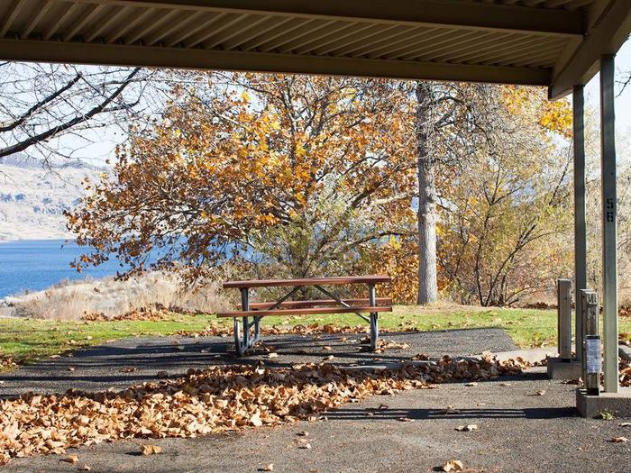 """Back in paved parking under a steel structure 9' 10"""" clearance.Site 56 overlooking the lake"""
