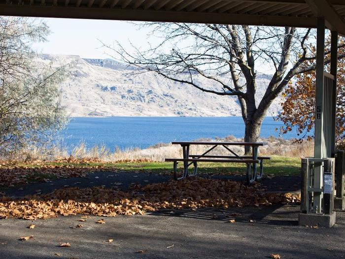 """Back in paved parking under a steel structure 10' 03"""" clearance.Site 58 overlooking the lake."""