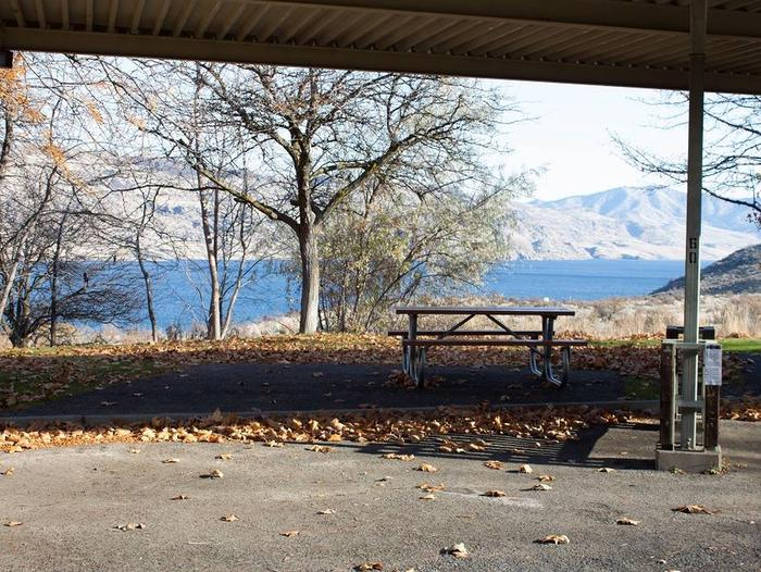 """Back in paved parking under a steel structure 10' 07"""" clearance.Site 60 overlooking the lake."""
