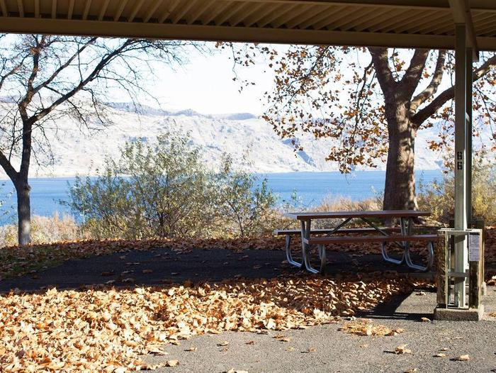 """Back in paved parking under a steel structure 10' 07"""" clearance.Site 66 overlooking the lake."""