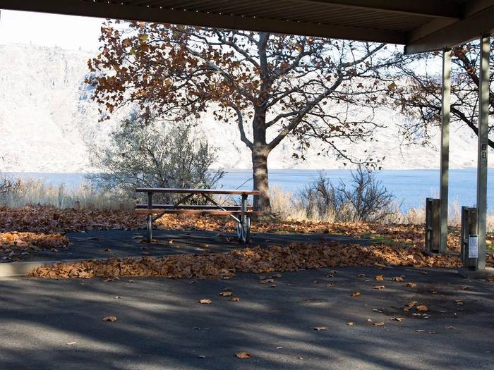 """Back in paved parking under a steel structure 10' 07"""" clearance.Site 68 overlooking the lake."""