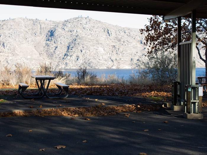 """Back in paved parking under a steel structure 10' 04"""" clearance.Site 70 overlooking the lake."""