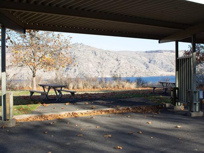 """Back in paved parking under a steel structure 10' 01"""" clearance.Site 72 overlooking the lake."""
