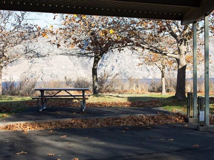 """Back in paved parking under a steel structure 10' 07"""" clearance.Site 74 overlooking the lake."""