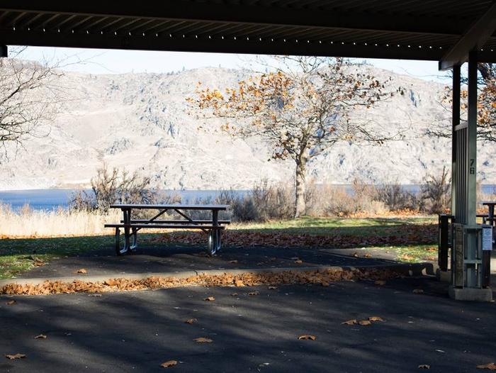 """Back in paved parking under a steel structure 10' 03"""" clearance.Site 76 overlooking the lake."""