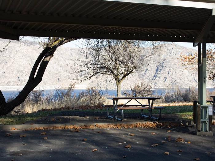 """Back in paved parking under a steel structure 9' 11"""" clearance.Site 78 overlooking the lake."""