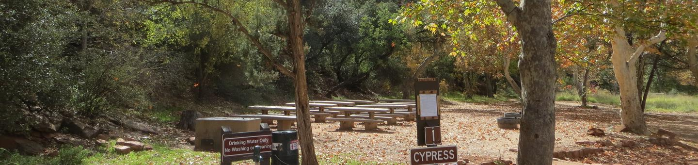 Group Site #1 at Chavez Crossing Campground featuring shaded trees and picnic and camping space.