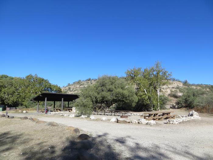 Clear Creek Campground Group Site featuring the shaded picnic area and camp space.