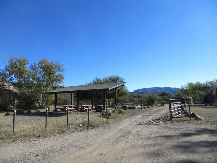 Clear Creek Campground Group Site showing the entrance to the shaded picnic area from parking space and mountain views.