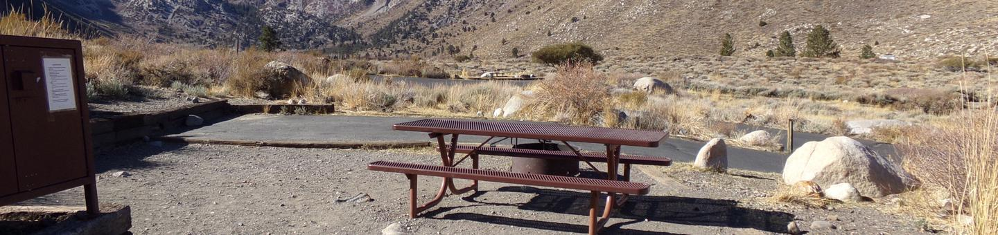 View of mountains and campground from campsite #4 at Convict Lake Campground.View of mountains and campground from campsite #4 at Convict Lake Campground featuring picnic table, fire pit, parking and camping space, and food storage.
