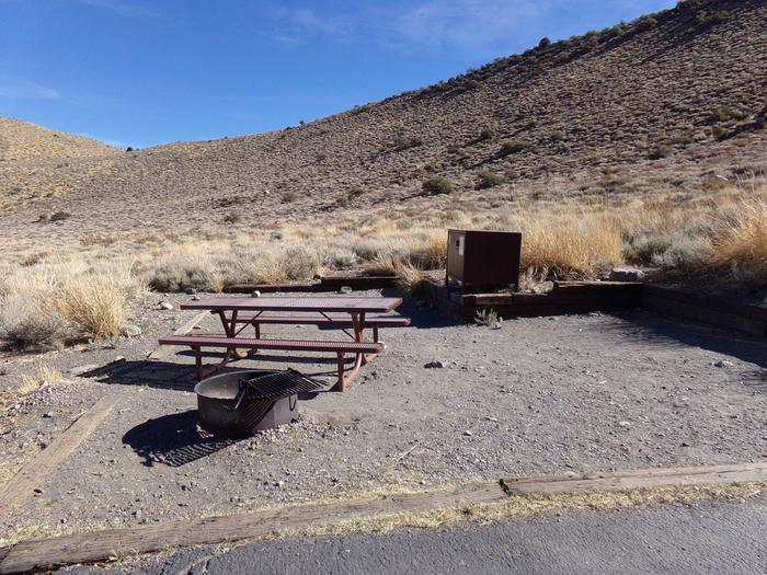 Picnic, camping space, bear resistant food storage, and fire pit for site #4 at Convict Lake Campground.