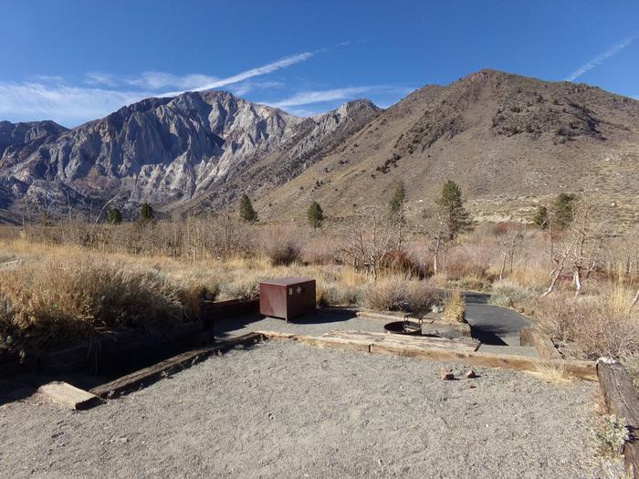 Camping space area on raised level at site #13 featuring full site and mountain views at Convict Lake Campground.