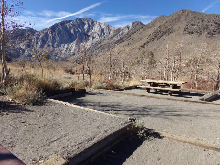 Additional view of camping area that includes picnic table and fire pit at site #15, Convict Lake Campground.