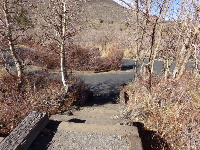 Steps down to parking and campground view for site #15 at Convict Lake Campground.