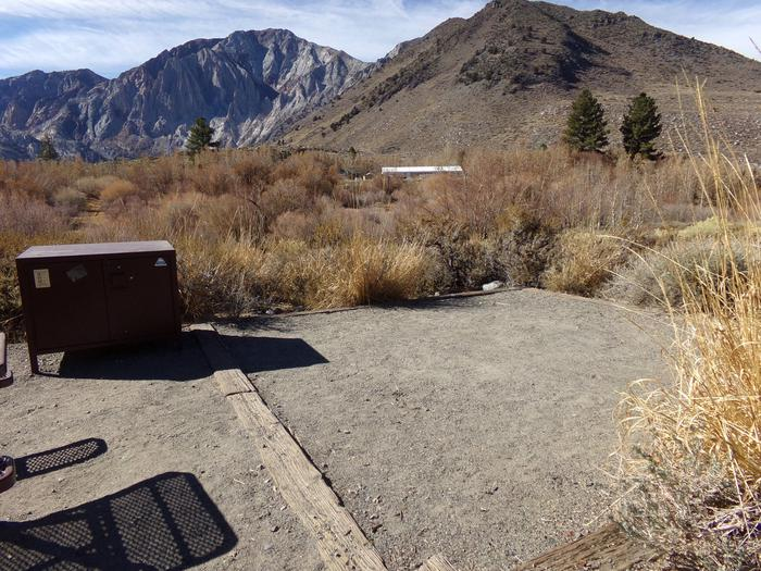 View of camping space, bear resistant food storage, and views of campground and mountains from site #32, Convict Lake Campground.