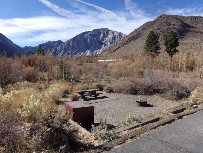Convict Lake Campground site #33 view of camp space with picnic table, fire pit, and food storage.View of entrance to site #33 featuring camp space with picnic table, fire pit, food storage, and mountain views.