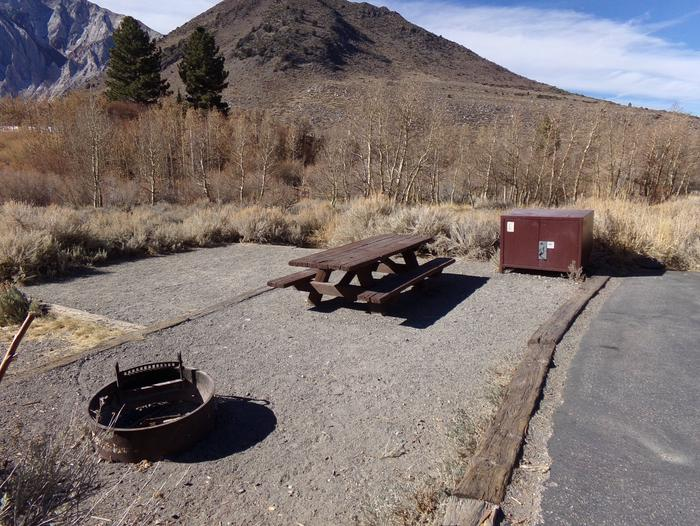 Convict Lake Campground site #34 featuring camping space, picnic table, food storage, and fire pit.Full campsite view from entrance to site #34. Creekside and mountain views.