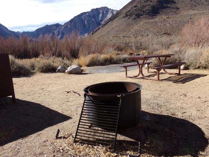 Mountain views from campsite #43 at Convict Lake Campground with provided picnic table, bear resistant food container, and fire pit.