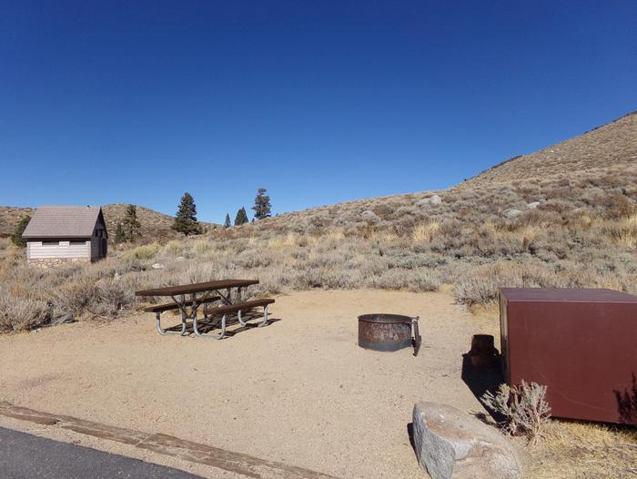 Convict Lake Campground site #51 featuring picnic table, food storage, and fire pit backing up to mountain. Convict Lake Campground site #51 featuring picnic table, food storage, and fire pit backing up to mountain. Close proximity to restrooms.