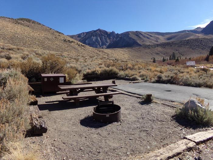 Convict Lake Campground site #55 featuring full campsite view backing up to mountain.Convict Lake Campground site #22 featuring full campsite view backing up to mountain. Picnic table, fire pit, and bear resistant food storage provided.