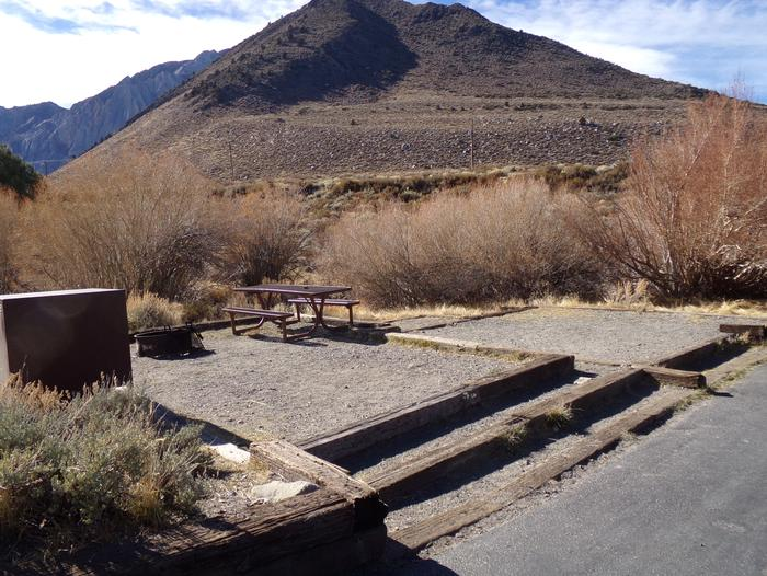 Full campsite #57 view with provided picnic table, fire pit, food storage, and camping space at Convict Lake Campground.