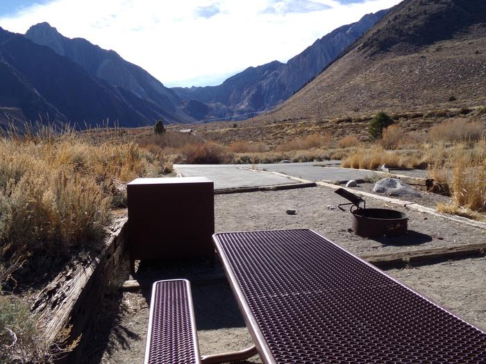 Alternate view of site #59 at Convict Lake Campground featuring entrance and parking to site with mountain views.