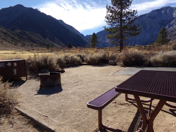 Full campsite #75 view featuring trees and mountain views at Convict Lake Campground.