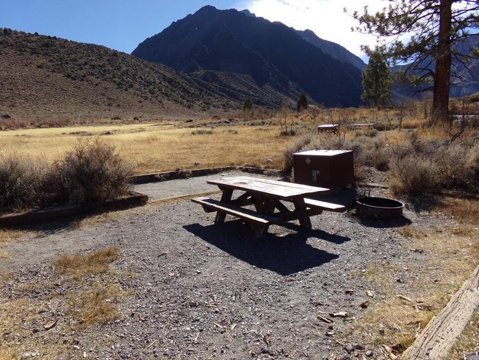 Campsite #76 at Convict Lake Campground featuring camping space, picnic table, food storage, and fire pit. Campsite #76 at Convict Lake Campground featuring camping space, picnic table, food storage, and fire pit.