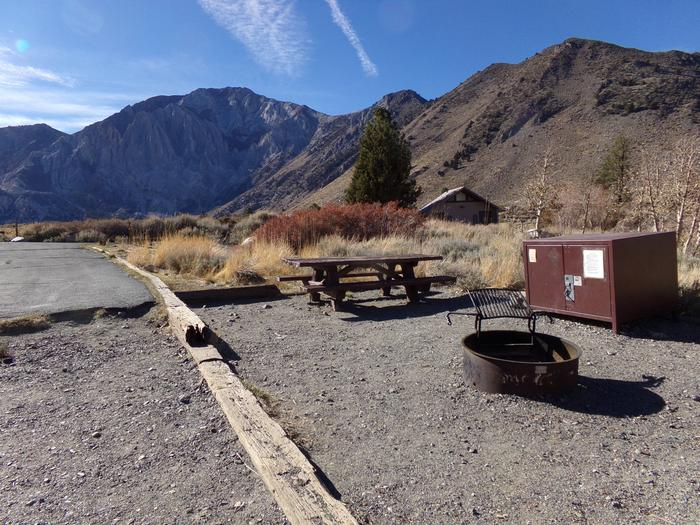 View of campsite #83 at Convict Lake Campground from camping area with mountain views.