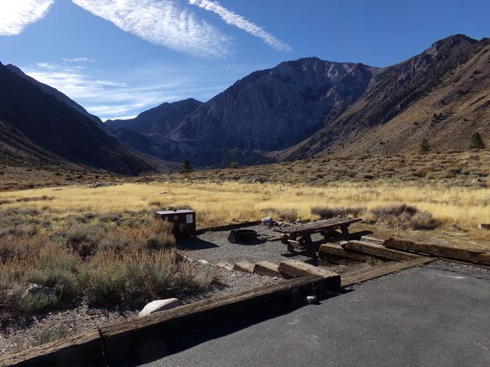 Broader view of site #87 at Convict Lake Campground from parking space. Broader view of site #87 at Convict Lake Campground from parking space. Backs to meadow and has panoramic mountain views.