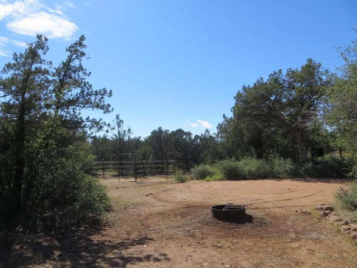 Houston Mesa, Horse Camp site #11 featuring camping space, fire pit and horse corral.