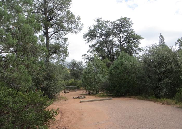 Parking space and entrance to wooded site #11, Mountain Lion Loop at Houston Mesa.