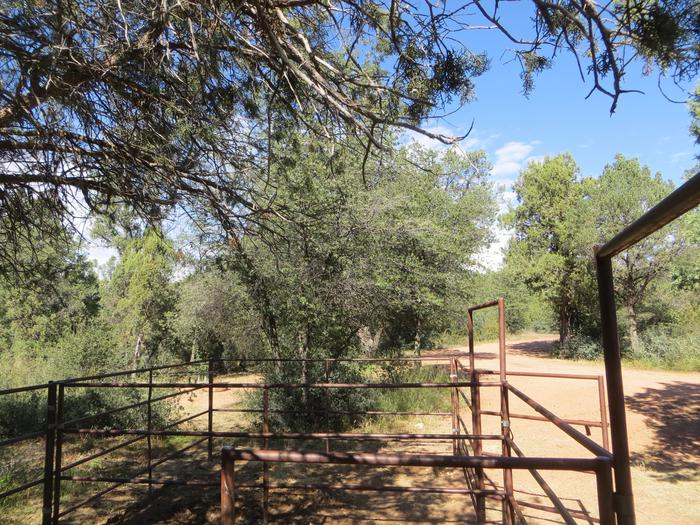 Provided horse corral and view of camping space and parking at site #12, Horse Camp, Houston Mesa.