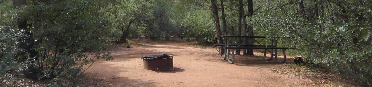 Houston Mesa, Elk Loop site #24 featuring large camping space with picnic table and fire pit.