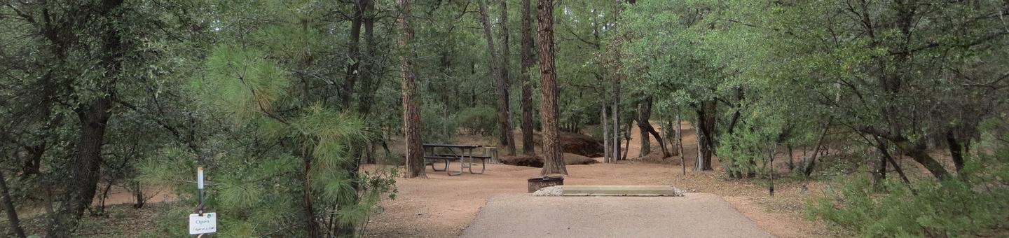 Houston Mesa, Black Bear Loop site #26 featuring parking, entrance to the wooded site, and picnic area.