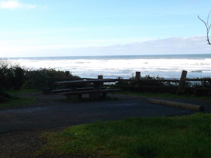 Picture of campsite with picnic table with an ocean viewCampsite D33