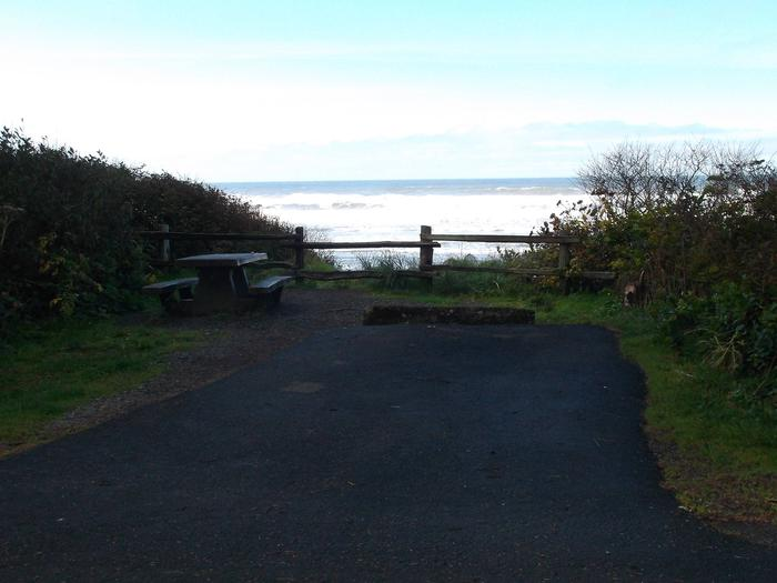 Picture of campsite with picnic table near the oceanCampsite D35
