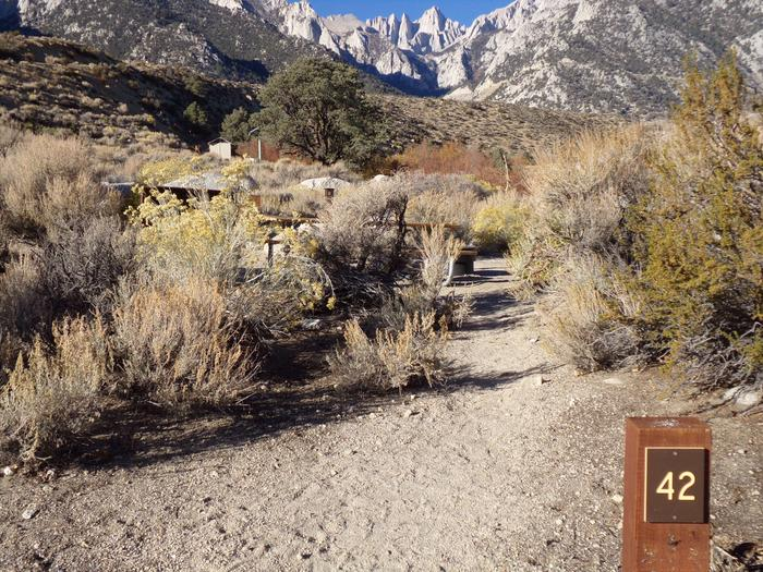 Entrance to site #42, Lone Pine Campground, with campsite and mountain views.