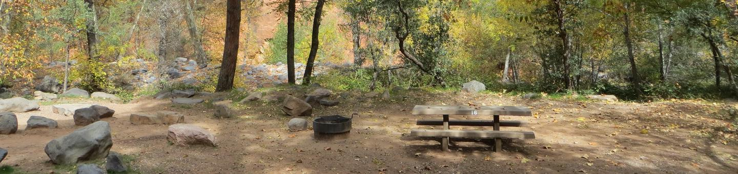 Manzanita Campground site #16 featuring the treed picnic area, camping space, and fire pit.