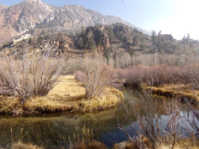 Crystal clear water providing fishing along with mountain views at Table Mountain Group Campground.