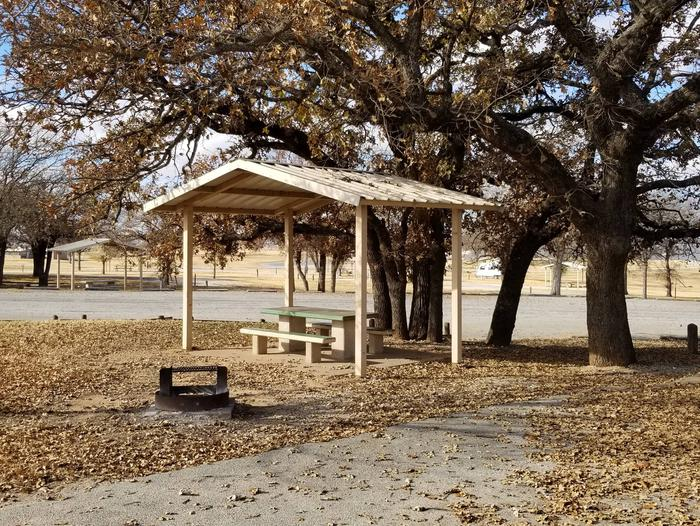 Site 20SView of Site 20S, including covered picnic table, shade trees, and fire ring