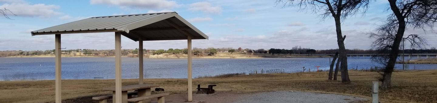 Site 24SView of Site 24S, including covered picnic table, shade trees, and lake view