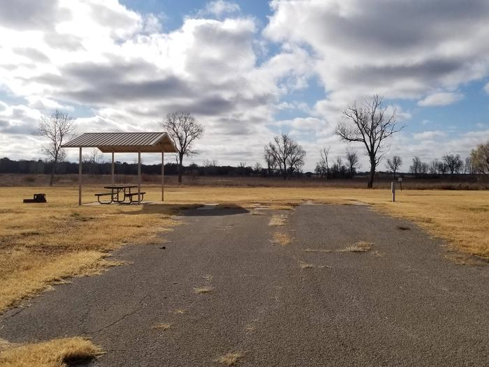 Site 42FView of Site 42F, highlighting covered picnic table, shade trees, and fire ring.
