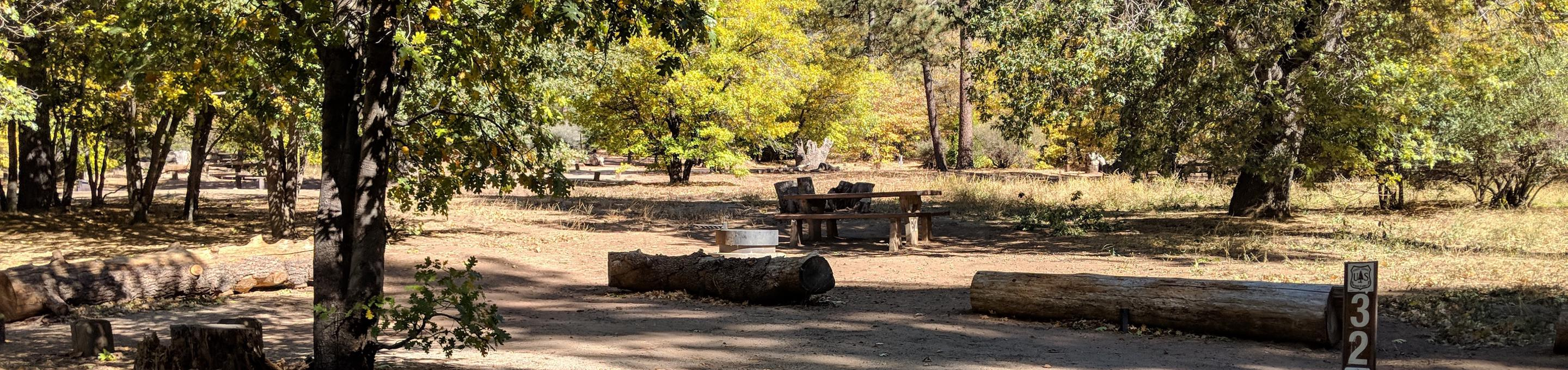 Laguna Campground site #32 wooded camping space view and picnic area.