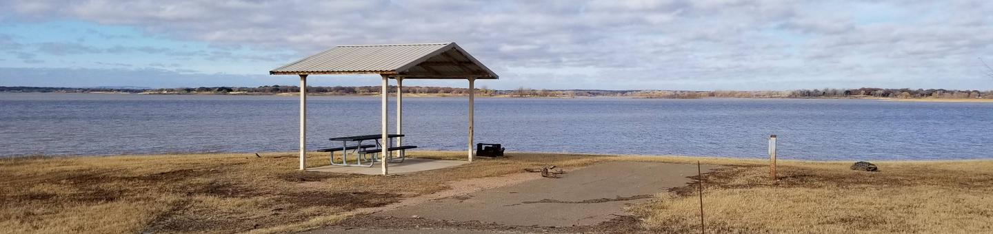 Site 60PView of Site 60P, highlighting covered picnic table, lake view, and fire ring.