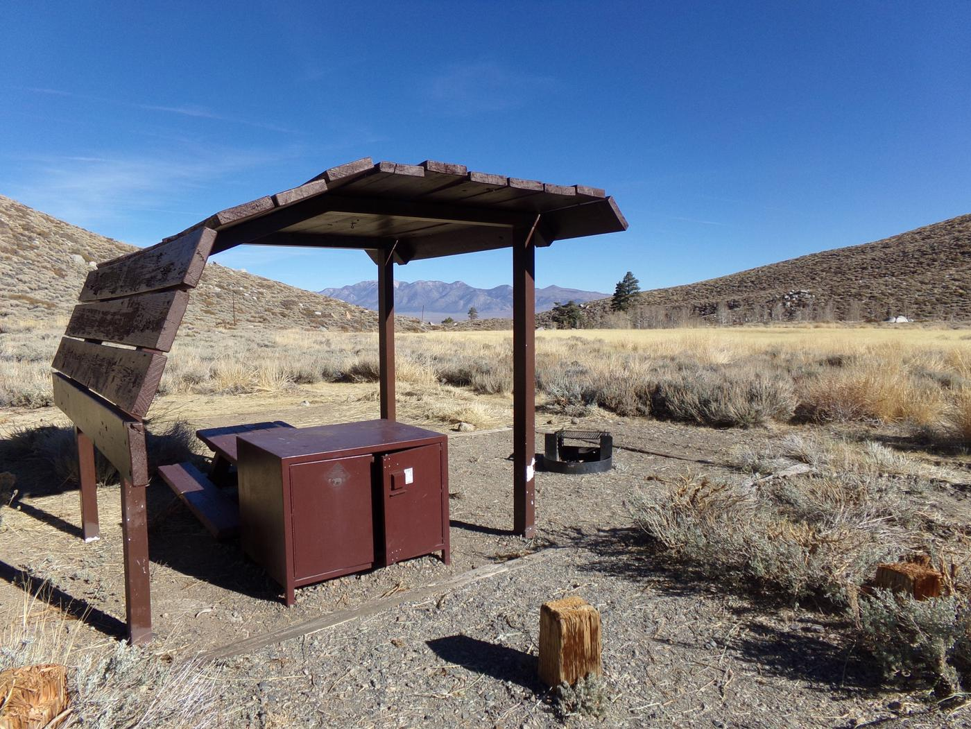 McGee Creek Campground site #01 featuring shaded picnic area with fire pit and camping space.
