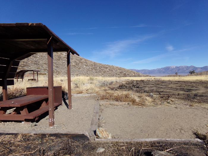 McGee Creek Campground site #03 featuring shaded picnic area with fire pit and camping space.