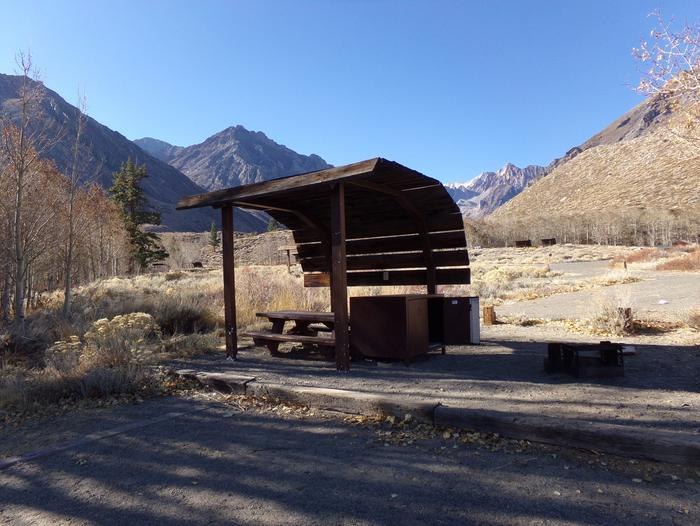 McGee Creek Campground site #09 featuring shaded picnic area with fire pit and camping space.